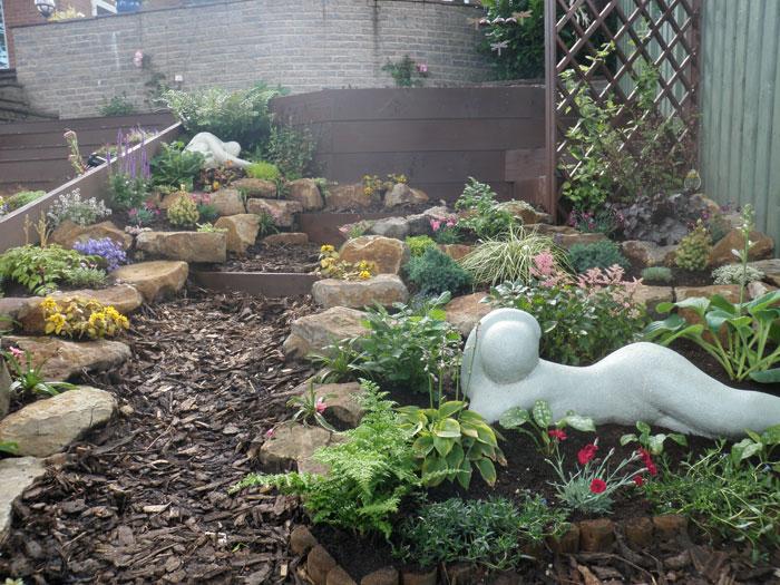 Artnoire garden design in fylde wyre and garstang for Planting schemes for small gardens